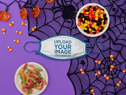 Mockup of a Face Mask Surrounded by Halloween Candy m116