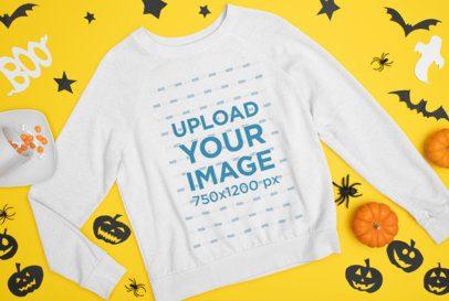 Mockup of a Flat Laid Sweatshirt Featuring Halloween Decorations m87