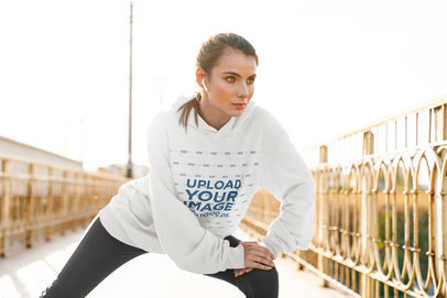 Oversized Hoodie Mockup of a Woman Stretching Her Legs Before Running 40269-r-el2