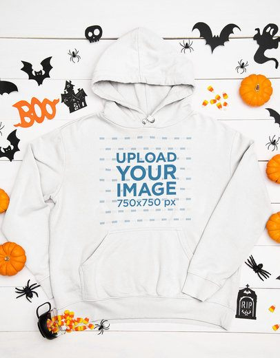 Mockup of a Flat Laid Pullover Hoodie Surrounded by Halloween Decor Items 94