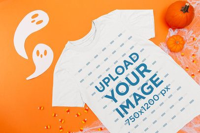 Mockup of a Flat Laid T-Shirt on a Surface with Halloween Items 109