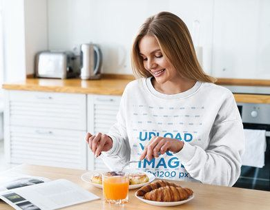 Mockup of a Happy Woman with a Sweatshirt Having Breakfast at Home 39559-r-el2