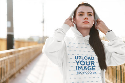 Mockup of a Woman Wearing a Pullover Hoodie in an Urban Setting 39894-r-el2