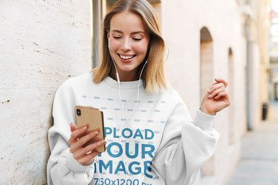 Sweatshirt Mockup of a Young Woman Listening to Music on the Street 39547-r-el2