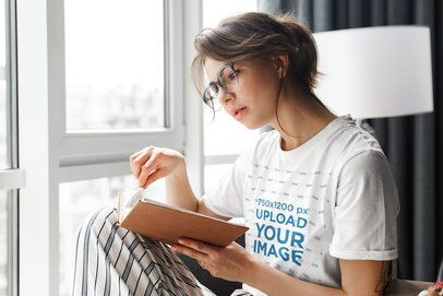 T-Shirt Mockup of a Woman Reading a Book at Home 39551-r-el2