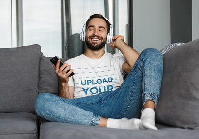 T-Shirt Mockup of a Man Enjoying Some Music at Home 39548-r-el2
