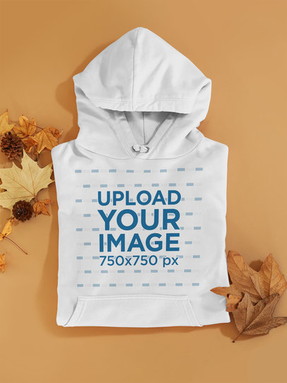 Mockup of a Folded Hoodie Among Some Autumn Leaves126