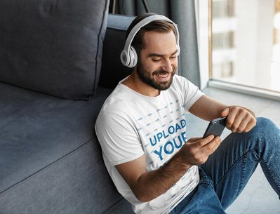 Mockup of a Man Wearing a T-Shirt While Listening to Music at Home 40571-r-el2