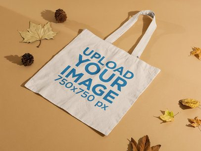 Tote Bag Mockup Featuring Dried Leaves and Pine Cones 123