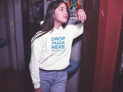 Young Girl Wearing a Pullover Hoodie While Waiting Outside a Bathroom a13593