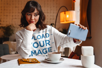 Sweatshirt Mockup of a Woman Taking a Selfie at a Coffee Shop 40254-r-el2