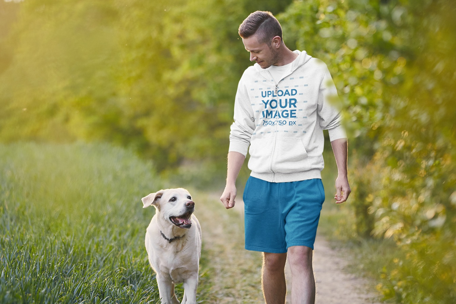 Hoodie Mockup of a Man Walking with His Dog in the Park 42924-r-el2