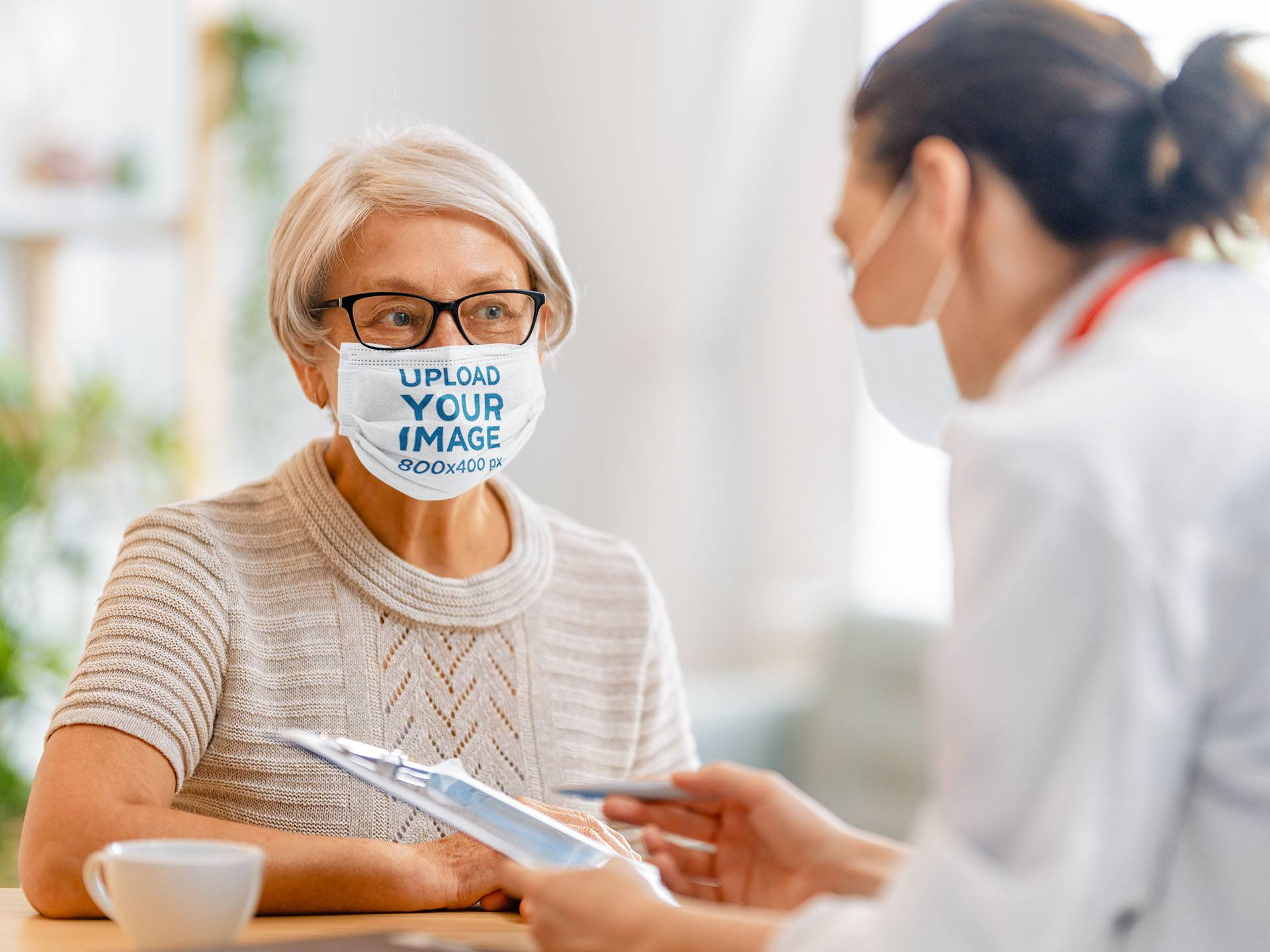 Face Mask Mockup of a Senior Woman Talking to the Doctor 43822-r-el2