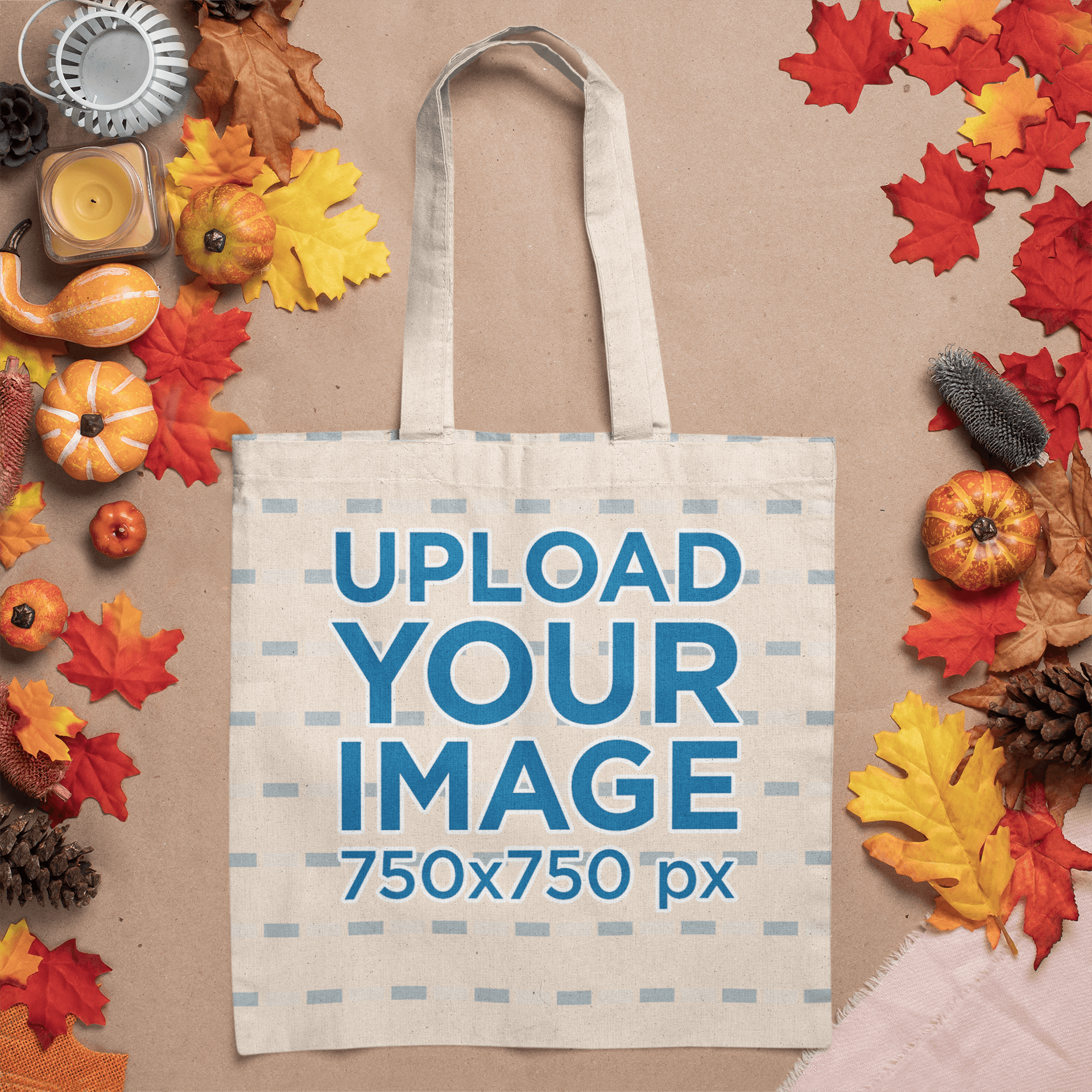 Mockup of a Tote Bag Lying Flat Among Autumn Decorations m50