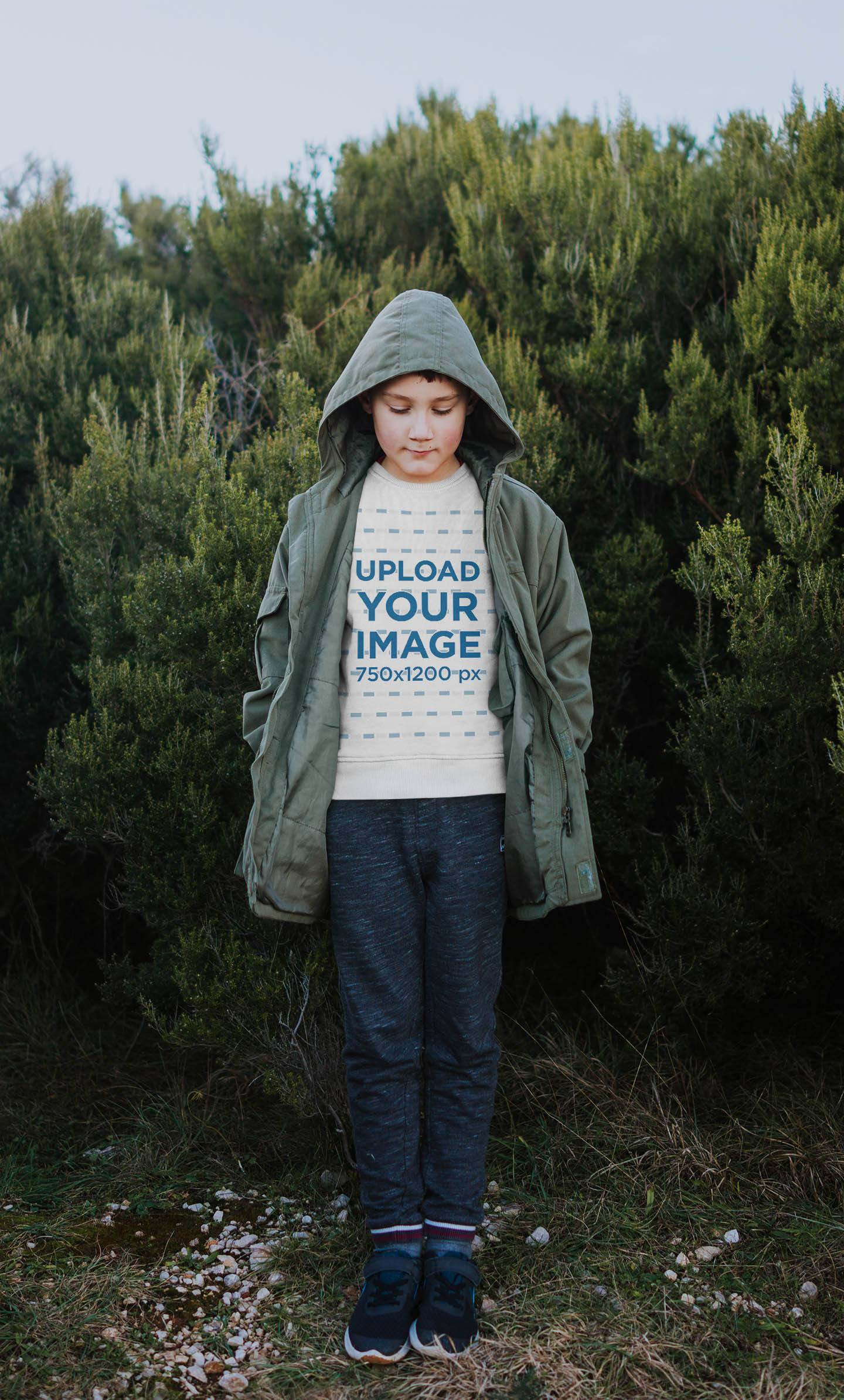 Sweatshirt Mockup Featuring a Boy Standing in Front of Some Bushes 35512-r-el2