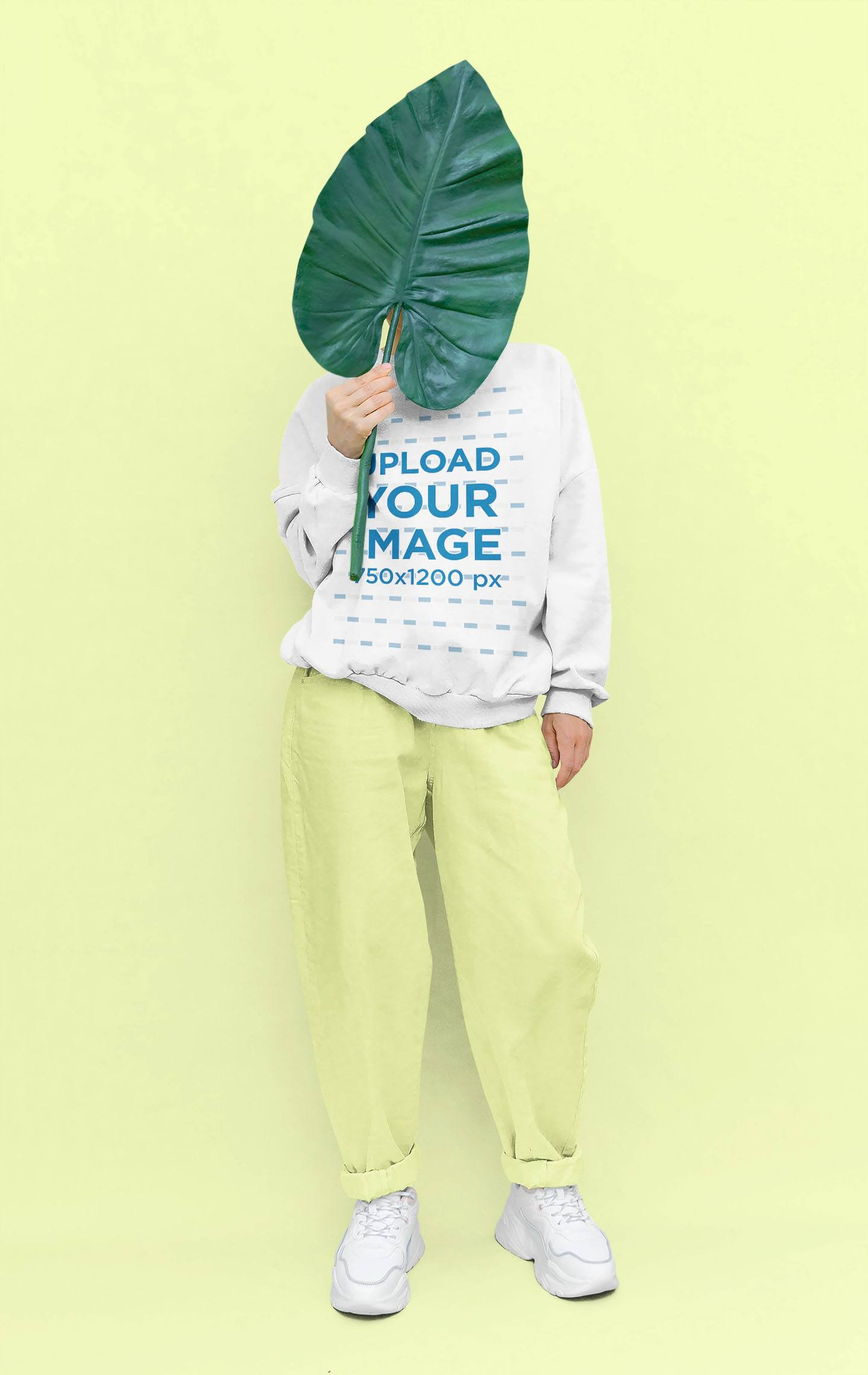 Sweatshirt Mockup of a Woman Using a Leaf Prop in a Studio 43671-r-el2