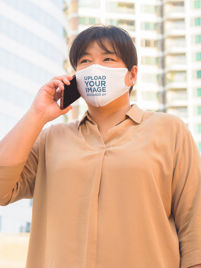 Face Mask Mockup Featuring a Woman Making a Phone Call in the City 44027-r-el2