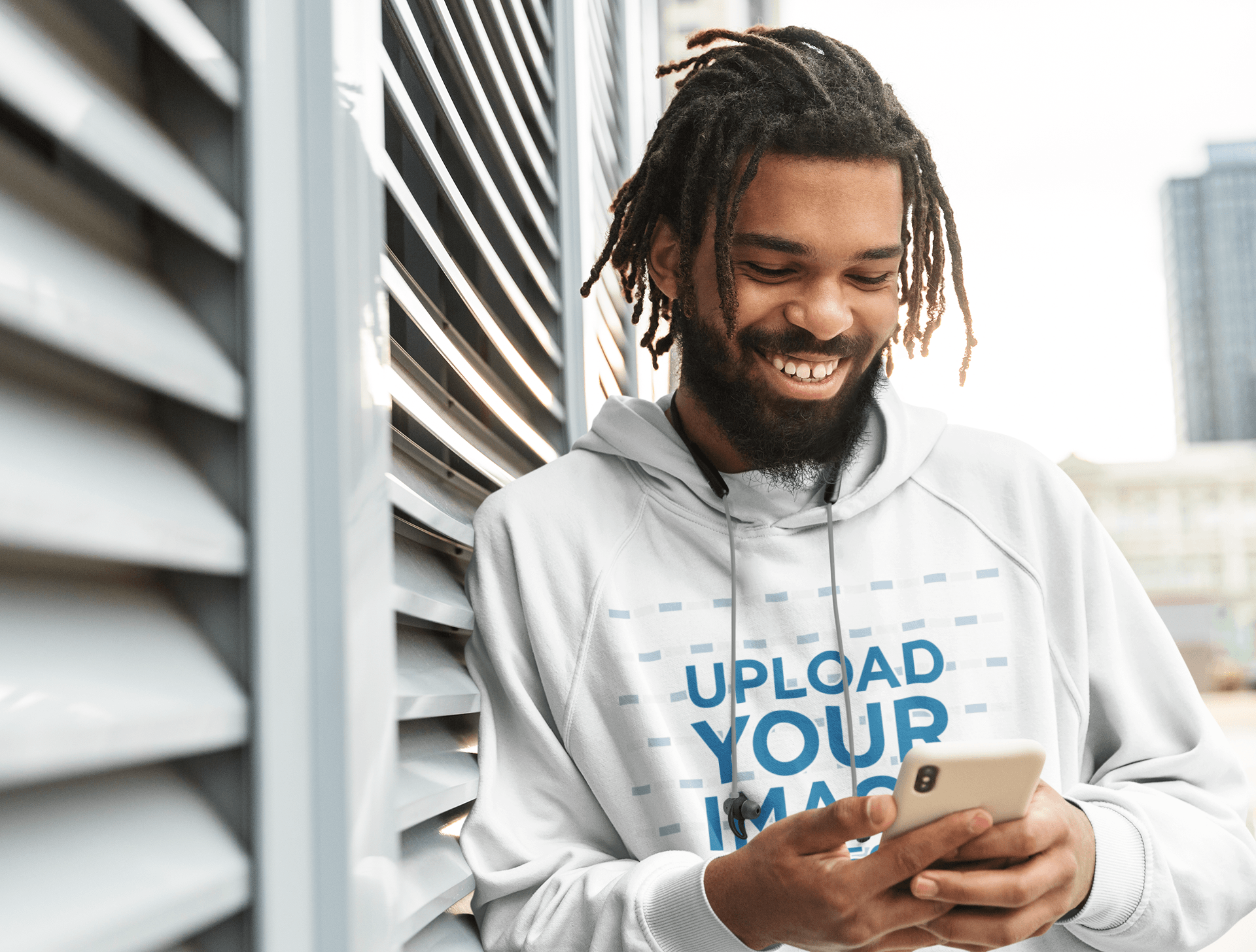 Hoodie Mockup Featuring a Man Reading a Funny Message on His Phone 42626-r-el2
