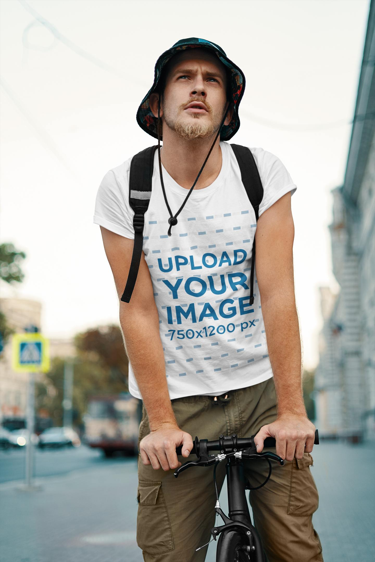 Mockup of a Man with a Basic Tee Riding a Bike on the Street 39309-r-el2