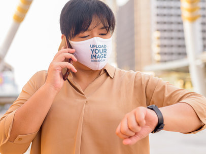 Face Mask Mockup of a Woman Checking Her Wristwatch 44030-r-el2