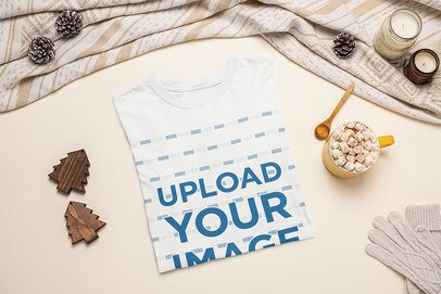 Mockup of a Folded T-Shirt Featuring a Hot Cocoa with Marshmallows m143