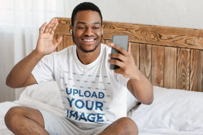 T-Shirt Mockup of a Man Doing a Video Call in His Bedroom 44292-r-el2