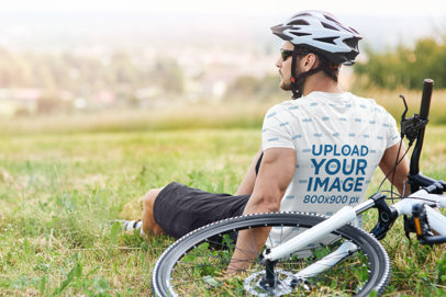Back-View Mockup of a Biker Wearing a Sublimated T-Shirt 44337-r-el2