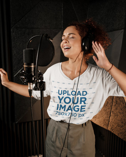 Oversized T-Shirt Mockup Mockup of a Curly-Haired Woman Singing 39733-r-el2