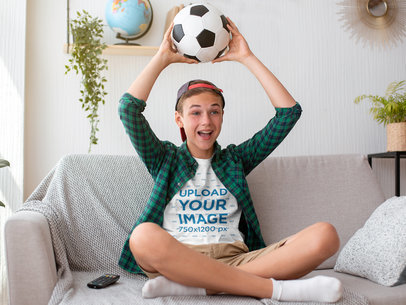 T-Shirt Mockup Featuring a Boy Watching a Soccer Match at Home 44142-r-el2