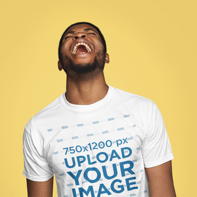 T-Shirt Mockup of a Man Laughing Out Loud in a Studio 40438-r-el2