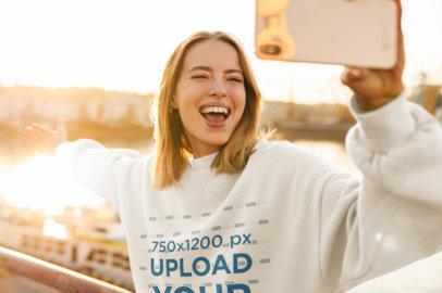 Sweatshirt Mockup of a Joyful Woman Taking a Selfie at Sunset 41516-r-el2