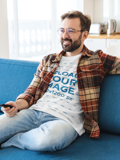 T-Shirt Mockup of a Bearded Man Watching TV at Home 43816-r-el2