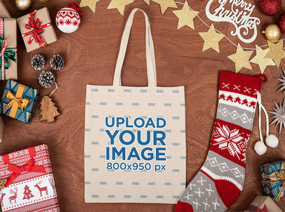 Mockup of a Tote Bag Placed on a Wooden Surface with Christmas Items m34