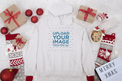 Pullover Hoodie Mockup Featuring Xmas Ornaments and Presents m40