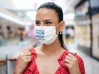 Mockup of a Woman Wearing a Face Mask in a Shopping Mall 44612-r-el2