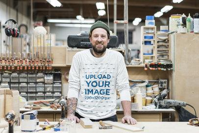 Sweatshirt Mockup of a Bearded Man in a Workshop 43064-r-el2