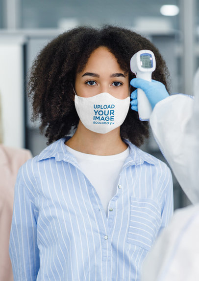 Face Mask Mockup Featuring a Curly-Haired Woman Getting Her Temperature Checked 44064-r-el2