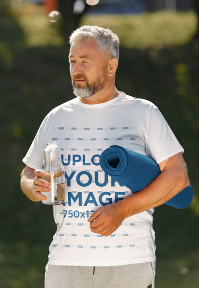 T-Shirt Mockup of a Senior Man About to Do Yoga 43883-r-el2