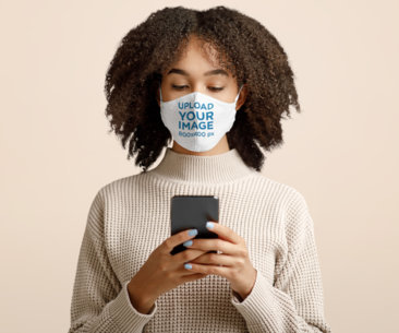 Face Mask Mockup of a Woman Checking Her Phone in a Studio 44686-r-el2