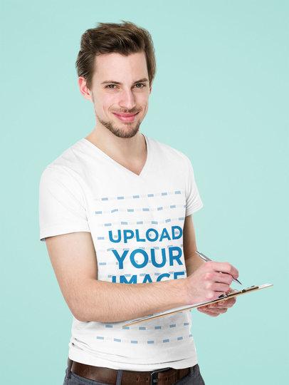 V-Neck T-Shirt Mockup of a Man Taking Notes in a Studio 44463-r-el2