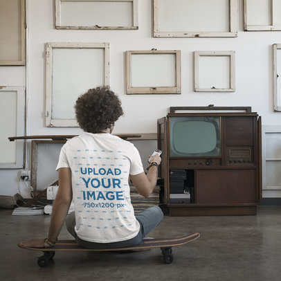 Back View Mockup Featuring a Curly-Haired Man Watching an Old TV 43248-r-el2