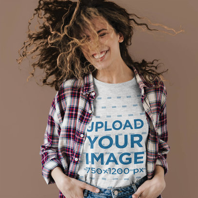 Mockup of a Happy Woman Wearing a Heather T-Shirt Against a Plain Backdrop 42818-r-el2