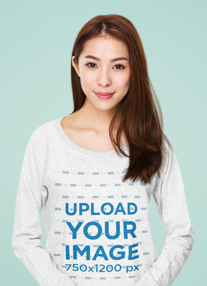 Mockup of a Smiling Woman Wearing a Heather Long Sleeve Tee at the Studio 44565-r-el2