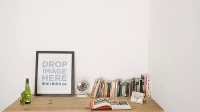 Video of a Young Man Sitting Down on a Desk at Home With a Framed Art Print Mockup a14349