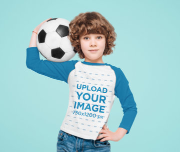 Raglan Long Sleeve Tee Mockup Featuring a Curly-Haired Kid Holding a Soccer Ball 43891-r-el2