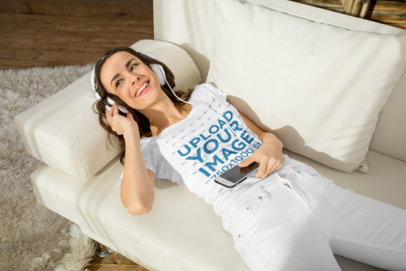 T-Shirt Mockup of a Woman Laid on a Couch Listening to Music 44364-r-el2