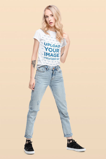 T-Shirt Mockup of a Woman With Tattoos Standing in a Studio 44536-r-el2
