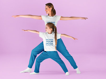 T-Shirt Mockup of a Woman Doing Yoga With Her Daughter in a Studio 43887-r-el2