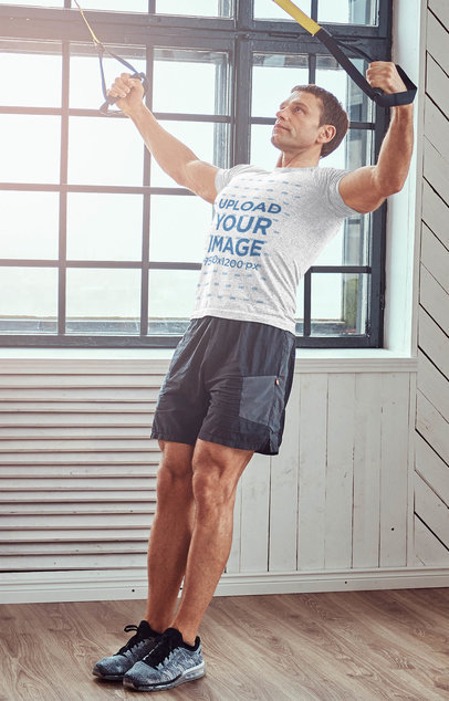 Heathered Tee Mockup of a Man Training at the Gym 43161-r-el2