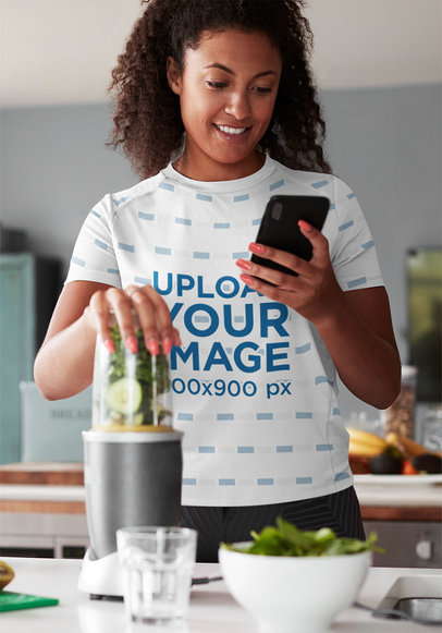 Mockup of a Woman in a Sublimated Tee Making a Healthy Juice 43947-r-el2